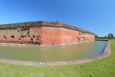 Cannon damage to exterior wall caused during Union attack during Civil War. The undamaged corner was quickly rebuilt by Union forces after taking it from the Confederates. Fort Pulaski, GA. © 2021 Kenneth R. Sheide