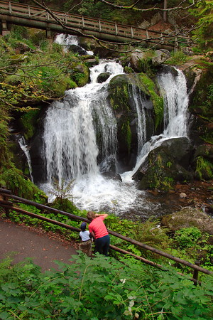 A mother shares one of the many waterfalls in Triberg, Germany. © 2004 Kenneth R. Sheide