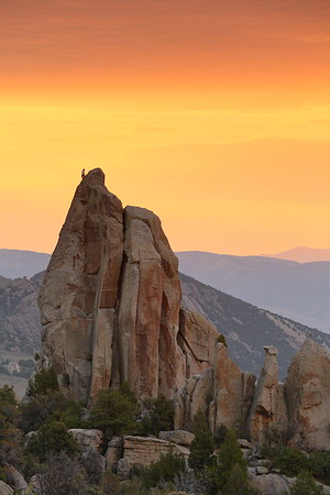 Climber atop Morning Glory Spire at sunrise. City of Rocks National Reserve, ID. © 2021 Kenneth R. Sheide