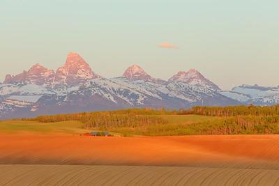 Sunset on grand tetons from farmland in Idaho. © 2013 Kenneth R. Sheide
