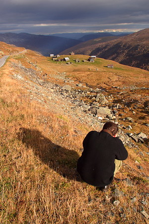 Photographer shooting a homestead in pass above Aurland, Norway. © 2004 Kenneth R. Sheide