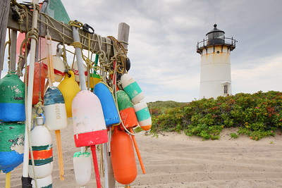 Collection of floats and Race Point Lighthouse. The current lighthouse was built in 1876 to replace the original 1816 rubble stone tower. Provincetown, MA. © 2021 Kenneth R. Sheide