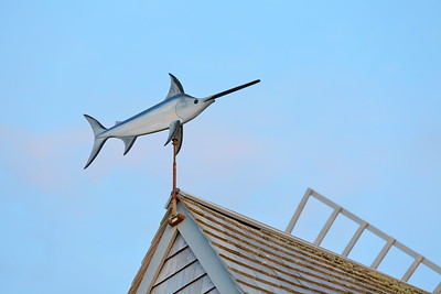 """Swordfish weather vane atop Godfrey Windmill, built 1797 and located in Chatham, MA. Written under the swordfish's sword is """"In Memory of Bill Appleyard"""". © 2021 Kenneth R. Sheide"""
