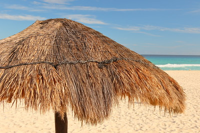 Thatch shade umbrella on Playa Delfines, Cancun, Quintana Roo, Mexico. © 2018 Kenneth R. Sheide