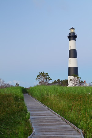 Marsh walkway leading to illuminated Bodie Island Lighthouse at dawn, Outer Banks, NC. © 2013 Kenneth R. Sheide