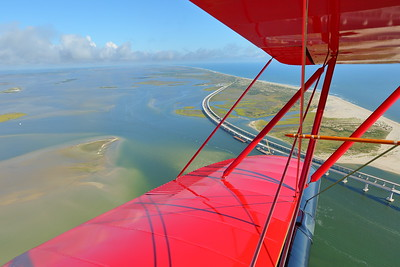 View past biplane wings of Bonner Bridge over Oregon Inlet, Outer Banks, NC. © 2018 Kenneth R. Sheide