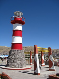 Lighthouse at harbor on edge of Lake Titicaca at Puno, Peru. © 2012 Kenneth R. Sheide
