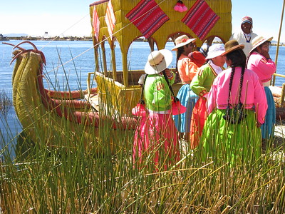 Peruvians in front of reed boat, Uros, Lake Titicaca, Peru. © 2012 Kenneth R. Sheide