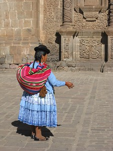 Peruvian lady feeding pigeons in front of Cathedral at Puno, Peru. © 2012 Kenneth R. Sheide