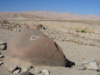 Heart petroglyph on rock at Miculla near Tacna, Peru. © 2011 Kenneth R. Sheide
