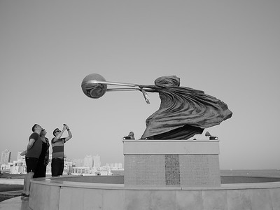 People photographing their reflection in Force of Nature statue, Katara, Doha, Qatar. © 2014 Kenneth R. Sheide