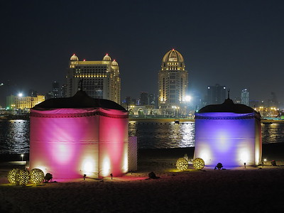 Tents on beach with West Bay towers in distance,. Katara, Doha, Qatar. © 2014 Kenneth R. Sheide