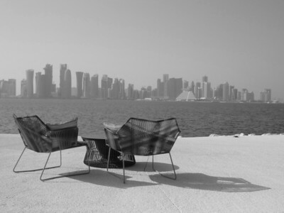 Table and chairs with Doha skyline in distance, Qatar. © 2014 Kenneth R. Sheide