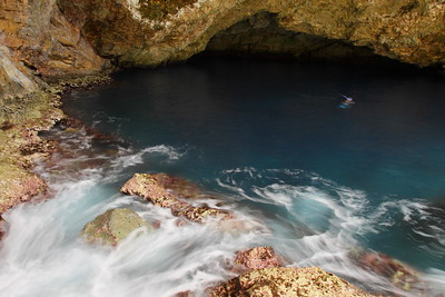 Ocean water rushing into The Grotto on Saipan. © 2010 Kenneth R. Sheide