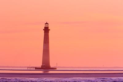 Morris Island Lighthouse at dawn, with Sullivan's Island lighthouse in distance. Folly Beach, SC. © 2021 Kenneth R. Sheide