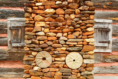 Old millstones used in cabin chimney at Hagood Mill, Pickens, SC. © 2021 Kenneth R. Sheide