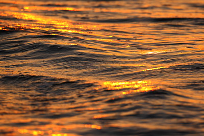 Ocean waves reflect sunset light. Hampton, VA. © 2007 Kenneth R. Sheide