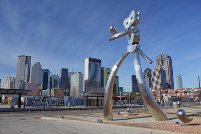 Traveling Man, Deep Ellum, Dallas, TX towering over the downtown area. © 2014 Kenneth R. Sheide