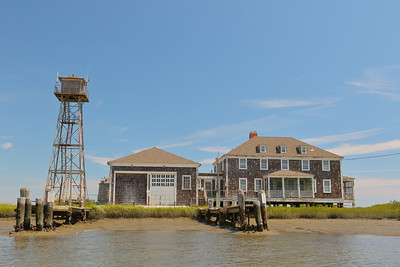 Cedar Island Life Saving Station, also known as Metomkin (or Metompkin) Inlet Station. Built in 1936 and turned over to Virginia in 1964. Now privately owned.  You can see the docks have completely silted up at lower tides preventing access. © 2020 Kenneth R. Sheide
