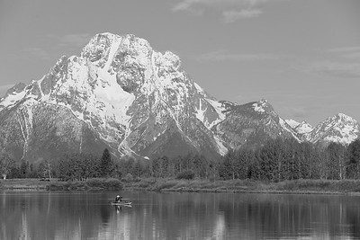 Kayaker enjoying morning at Oxbow Bend in Snake River with Mount Moran in distance, WY. © 2013 Kenneth R. Sheide