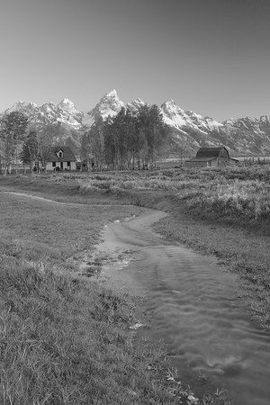 Creek flowing toward Snake River with old Mormon buildings and Grand Teton mountains in distance, WY. © 2013 Kenneth R. Sheide