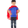 confident Superhero kid standing in studio