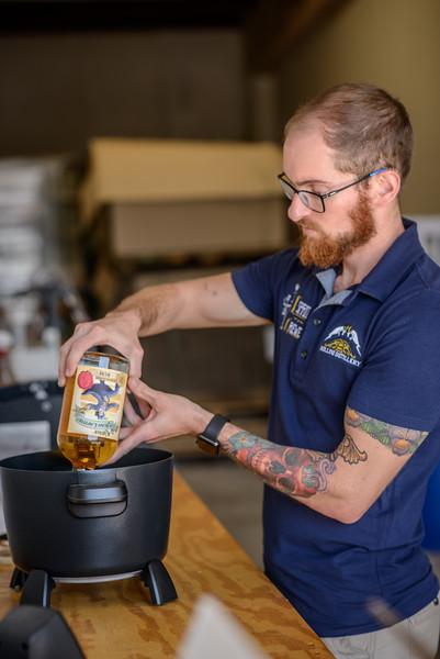 Hand Bottling Rum at Rollins Distillery