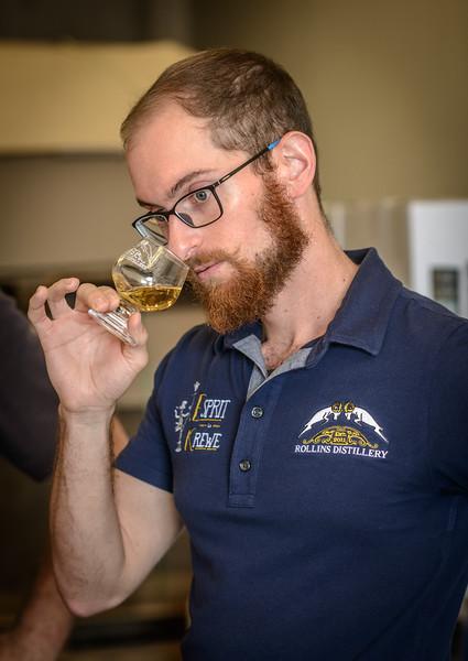 Patrick Taste Testing Batch of Rollins Distllery Rum