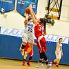 Bromfield senior Amanda Accorsi has her shot blocked by Annie McGee of Tyngsboro in the first quarter. Nashoba Valley Voice/Ed Niser