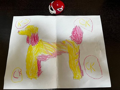 """A young fan draws the """"Chiefs Dog"""""""