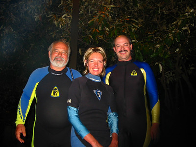 Jim, Amelia, and Philip at Ulua Beach for a night dive
