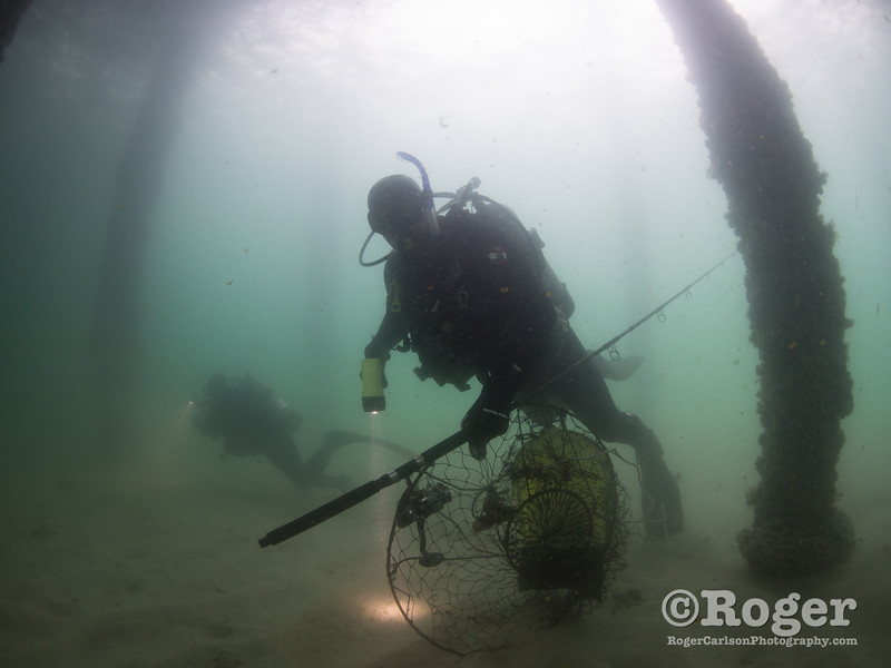 Divers under the pier with trash at Coastal Cleanup Day, underwater cleanup at the Redondo Pier and Veteran's Park.