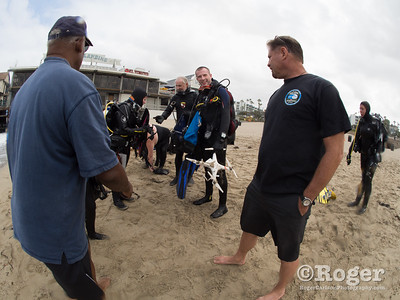 Divers with trash at Coastal Cleanup Day, underwater cleanup at the Redondo Pier and Veteran's Park.