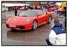 En del københavnere trodsede regnvejret lørdag maj 21.05.2005 for at beundre de flotte luksusbiler der var udstillet under Ferrari Days i København. Udover Farrari var der udstillet mange andre italienske luksusmærker:    Lamborghini, Maserati, Ducati, Alfa Romeo, Benelli, Moto Guzzi, Aprilia. Ferrari days fortsætter i næste weekend i Bruuns Galleri i Århus<br /> . Foto: Torben Christensen  København ©  Ayoe Bryndis