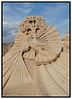 Søndag juni 26. 2005 åbnede den 10. Internationale Sandskulpturfestival, ved Femøren på Amager, officielt. Festivalens tema er H. C. Andersens eventyr, og fyrre skulptører fra hele verden deltager. Her en af vinderskulpturerne der illustrerer eventyret nattergalen, skabt af Fergus Milvanu, Irland. (Foto: Torben Christensen / Scanpix 2005) . Foto: Torben Christensen  København ©  Ayoe Bryndis
