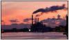 Rygende skorstene i silhuet mod rød himmel med solnedgang  på H.C. Østed Værket, Energi E2 . Foto: Torben Christensen  København ©