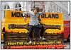 En marionetdukke i skikkelse af Miljøminister Connie Hedegaard under et banner med teksten ´Monsantoland ´ spillede hovedrollen da aktivister fra Greenpeace torsdag 15 maj. 2006 holdt demonstration på Højbro Plads udenfor Miljøministeriet som en protest imod at miljøministeriet nu på andet år fastholder den lovstridige hemmeligholdelse af fodringsforsøg med GMO - raps fra biotek - giganten Monsanto. En GMO - raps, som blandt andet forårsagede ti procent tab i kropsvægt og 16 procent forøget levervægt hos forsøgsrotter, der i blot 30 dage blev fodret med GMO ´en. . Foto: Torben Christensen  København ©