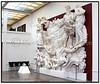 J.F. Willumsen. J.F. Willumsens Museum i Frederiksværk. J.F. Willumsens Museum er et enkeltkunstnermuseum skabt for billedkunstneren Jens Ferdinand Willumsen. Samlingen omfatter et bredt spektrum af J.F. Willumsens malerier, tegninger, grafik, keramik, skulptur, fotografier og arkitektur. Således er det via en gennemgang i museet muligt at følge én enkelt kunstners udvikling og at få et indblik i de mangeartede kunstneriske problemstillinger, han arbejdede med. Billedet viser udkast til Det Store Relief, 1893-1928. Flerfarvet marmor og andre stenarter samt forgyldt bronze, 440 x 646 cm. Deponeret af Statens Museum for Kunst på J.F. Willumsens Museum.. Foto: Torben Christensen  København ©