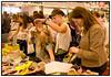 Varerne studeres grundigt under årets store tøjmesse, ´Designer Forum ´ i Forum i København der var fyldt til bristepunktet. Mere end 600 tøjmærker fra ind - og udland er til salg for stærkt nedsatte priser under mottoet ´Spar en formue - lign en million ´. . Foto: Torben Christensen  København ©