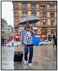 Der var ikke mange der trodsede det kraftige regnvej der  søndag 27. august 2006 passerede over københavn, Her er der dog en der ikke har tid til at vente på tørvejr på Rådhuspladsen. . Foto: Torben Christensen  København ©
