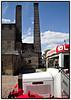 """Gammel Ølbil og skorstene på Carlsberg Besøgscenter i Det Gamle Carlsberg på Gl. Carlsbergvej . De første Carlsberg blev tegnet af J.C. Jacobsen i samarbejde med arkitekten H.C. Stilling.  J.C. Jacobsen kaldte bryggeriet """"Carlsberg"""" efter sin søn Carl og det gamle danske ord for bakke """"berg"""", der henviser til bryggeriets beliggenhed på Valby bakke.<br /> <br /> De oprindelige bygninger nedbrændte i 1867, men hele komplekset blev genopbygget samme år, men denne gang brugte man jern i stedet for træ som den bærende struktur. . Photo: Torben Christensen © Copenhagen, Foto: Torben Christensen  København ©"""