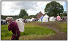 Deltager i  Riddermarkedet på Esrum Kloster og Møllegård søndag 20 juni 2010 bærer foder til hesten med telte i baggrunden. Over 400 udklædte, fortælleglade og levende middelalder-entusiaster på Klosterengen, satter præg på weekenden.  I flæng kan nævnes riddere, tempelherrer, falkonerer, kræmmere, gøglere, landsknægte, munke, lædersmeden, smykkemageren, spåkonen, instrumentmageren, rebslageren og smeden, historiefortællere, slagsbrødre, trubadurer, bueskytter, kanonerer, kællinger, krigere… . Photo: Torben Christensen © Copenhagen, Foto: Torben Christensen  København ©