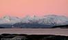 Tom malmbåt som er på tur innover Vesttfjorden like før den dreier inn bak Barøya og inn Ofotfjorden. I bakgrunnen Lødingen Vestbygd og fjellene i Vesterålen. Foto fra Efjord.