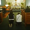 Two women pray before the Blessed Sacrament after Mass for Divine Mercy Sunday.  (Photo by Lance Murray / NTC)