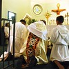 Msgr. Tawiah genuflects before the Blessed Sacrament.  (Photo by Lance Murray / NTC)