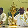 Msgr. Tawiah places the Blessed Sacrament on the altar at the beginning of Adoration.  (Photo by Lance Murray / NTC)