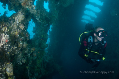 A diver swims through the interior of the Hardeep wreck, Pattaya, Thailand 2011