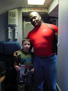 Hayden with WWF star Ahmed Johnson - he was on our plane back home