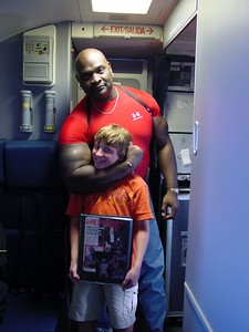 Harrison with WWF star Ahmed Johnson - his arm is BIGGER than Harrison's head!