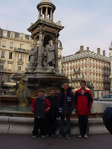 Harrison, Jake, Kara & JJ in front of fountain in Lyon